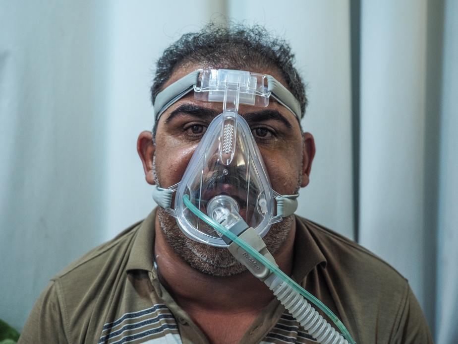Muhammad Yusef Radi, equipped with a continuous positive pressure ventilator