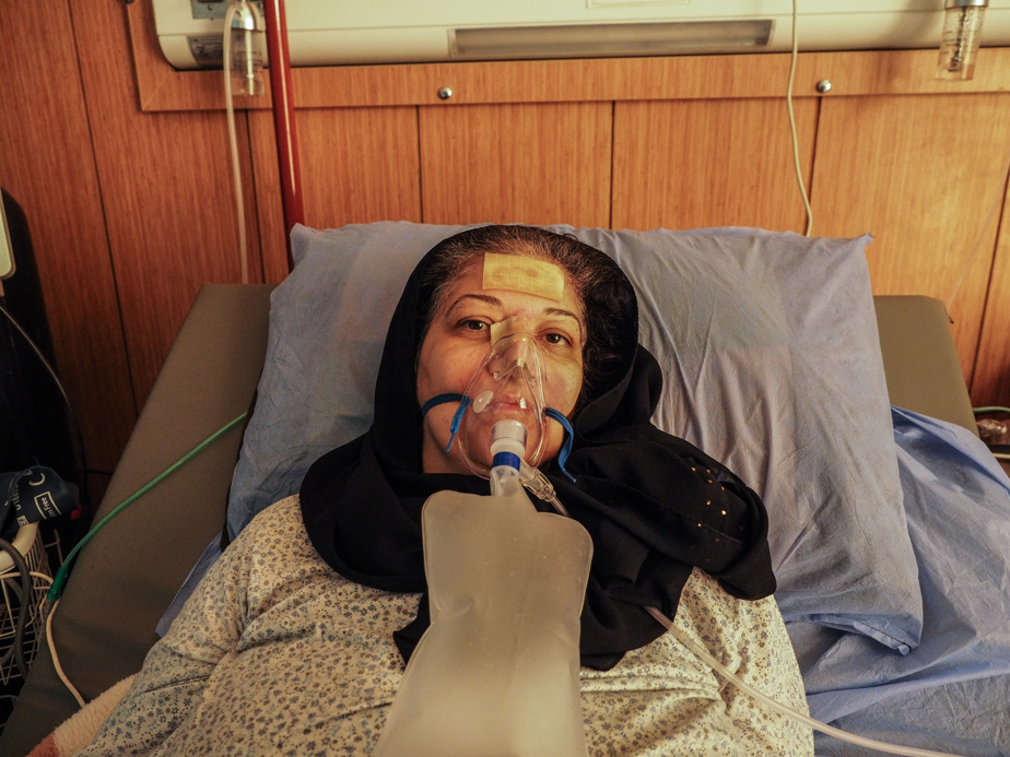 Mayada Fadel, 57, in her intensive care unit.  She was hospitalized 12 days ago.