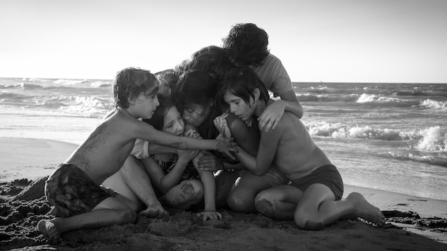 The children gathered together on the seashore