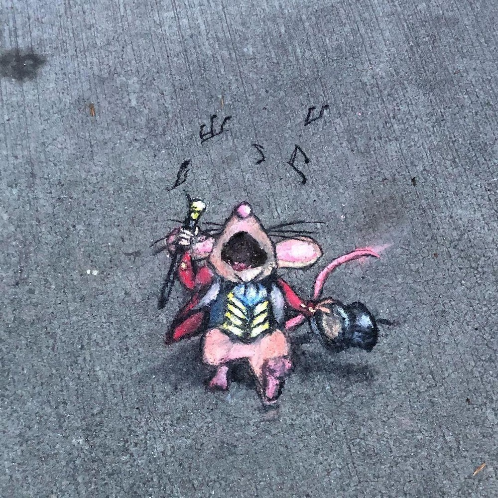 On the floor, a chalk drawing showing a mouse in costume singing.