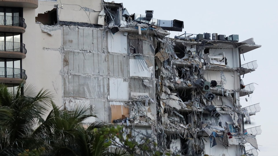 Partially destroyed multi-storey building.