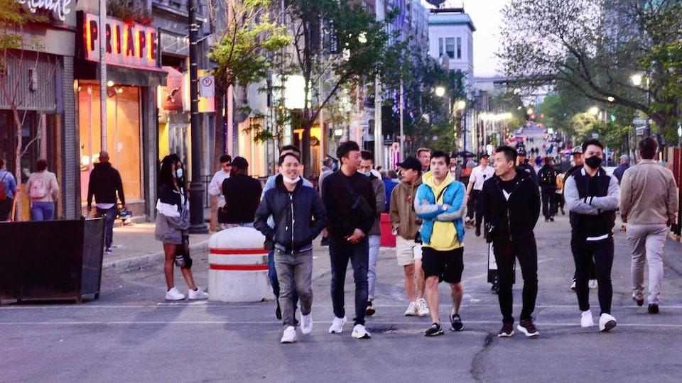 People walk in a pedestrian street.