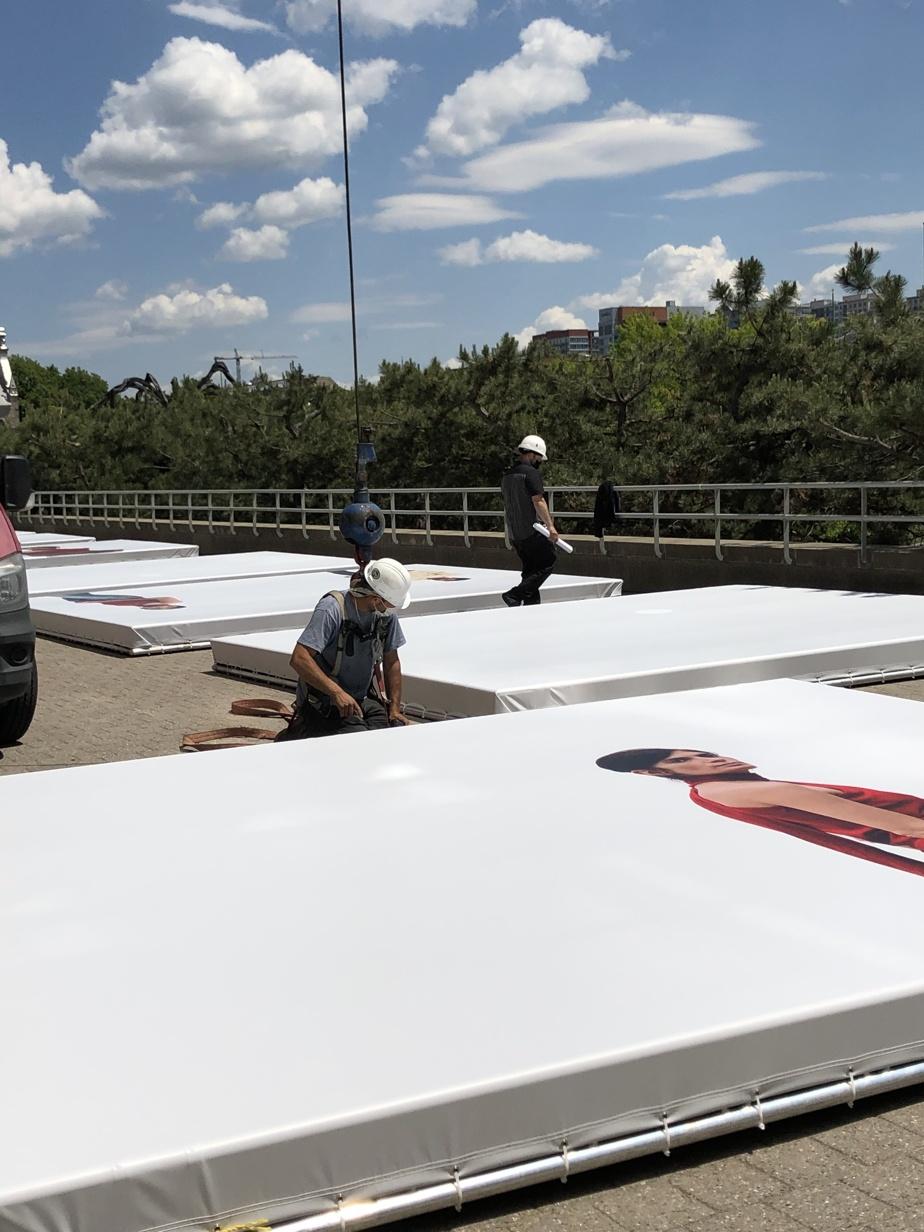 Technicians prepare photo montages.