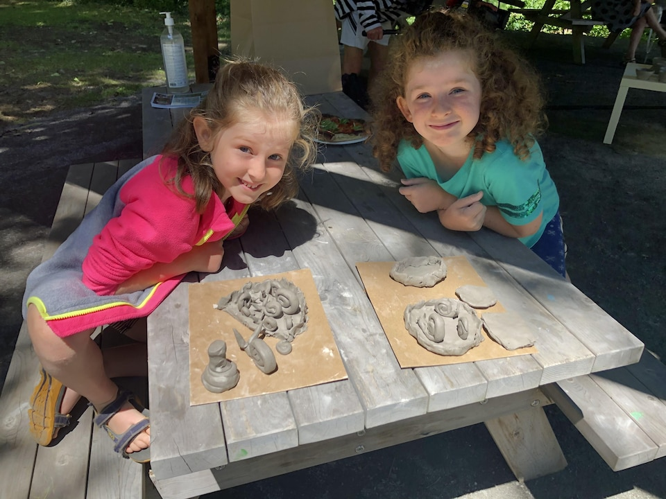 Two little girls making pottery