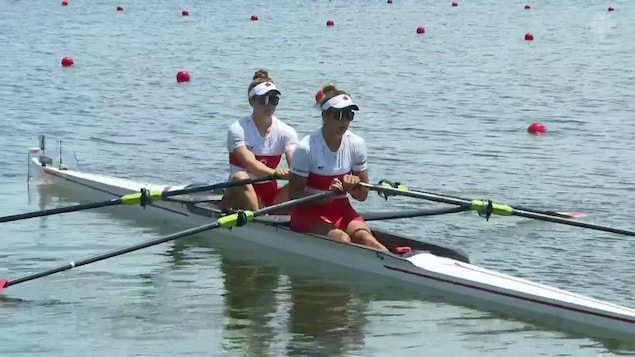 Two Canadian women sitting in a stationary paddle.