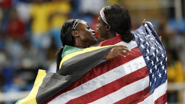 Gold medalist Elaine Thompson (Jamaica) kisses silver medalist Tori Boye (US) (right) after the women's 100m final at the 2016 Rio Olympics.