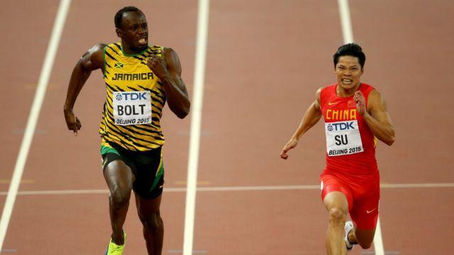 Bingtian Su, shown here running alongside Usain Bolt at the 2015 World Championships.