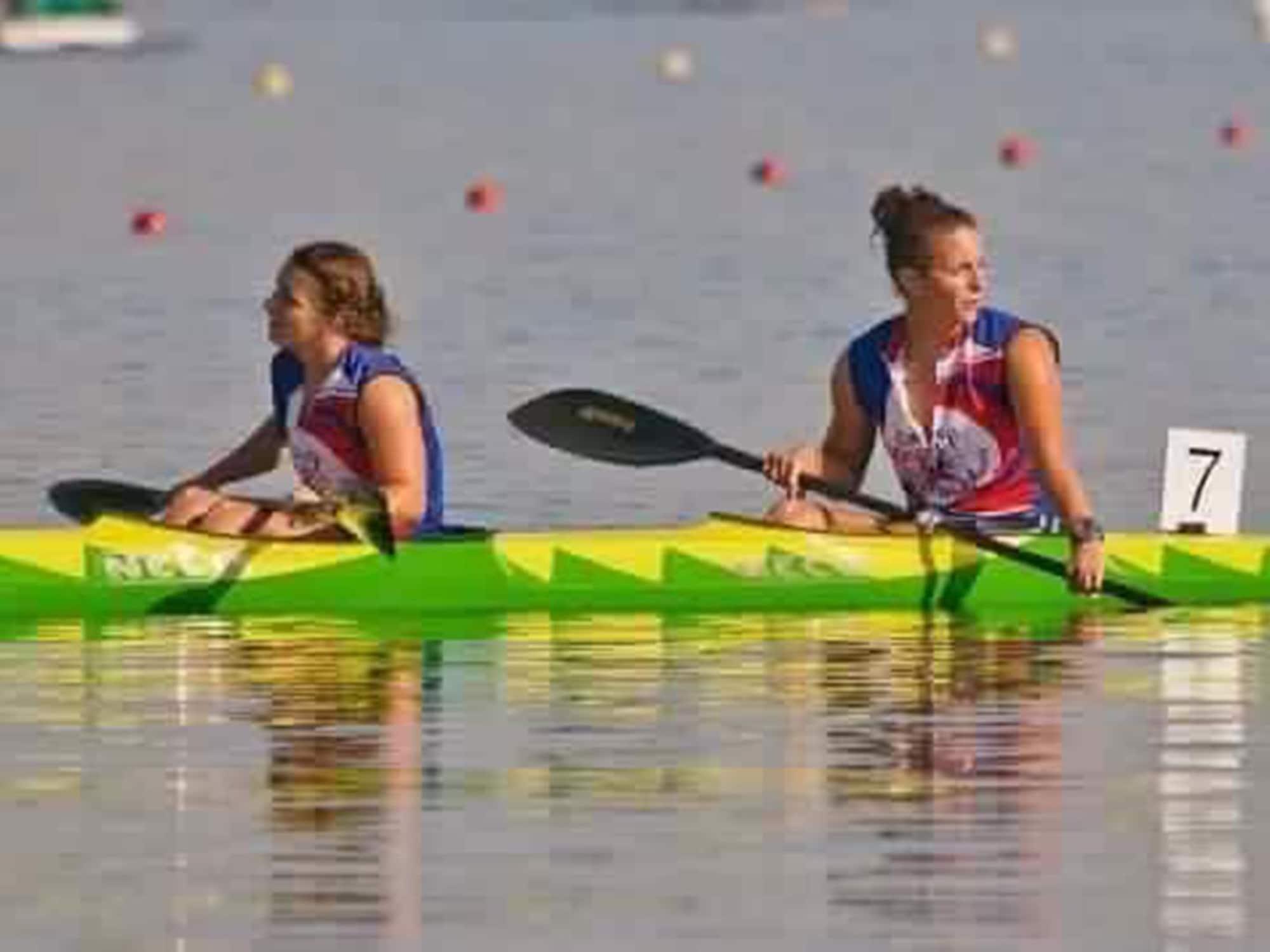 Two women sitting in a kayak.