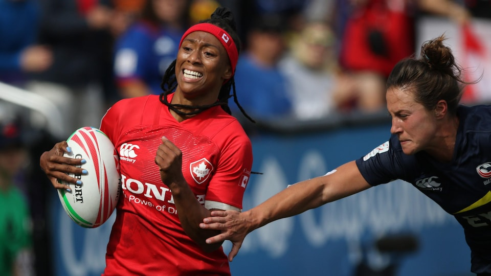 Charity Williams avoids dealing with Lauren Doyle in the rugby seven match between Canada and the United States.