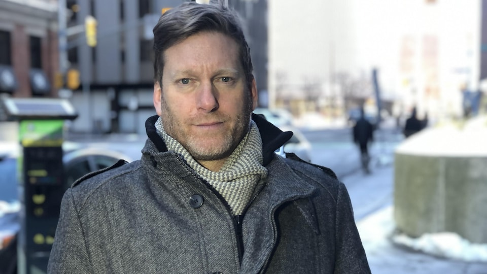 Portrait of a man, outdoors, winter, in downtown Ottawa.