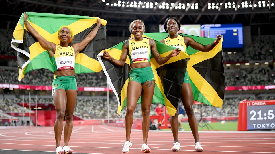 They each wave the Jamaican flag after their 100-meter triathlon.
