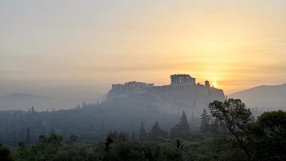 The Parthenon on the Acropolis at a smoky sunrise.