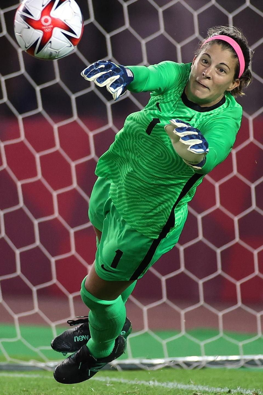 The goalkeeper saves.