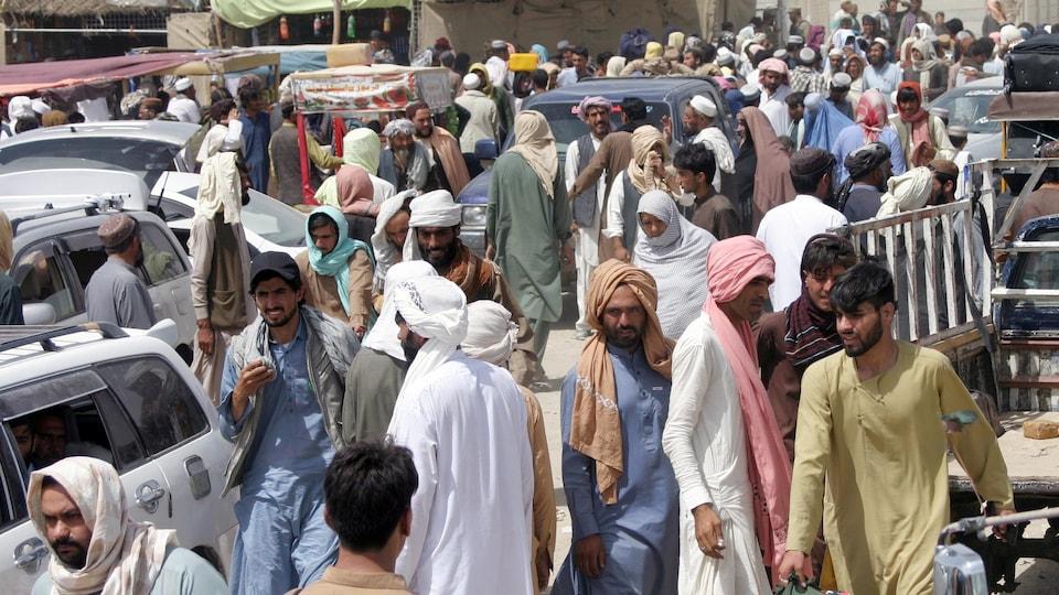 Hundreds of men roaming the street.