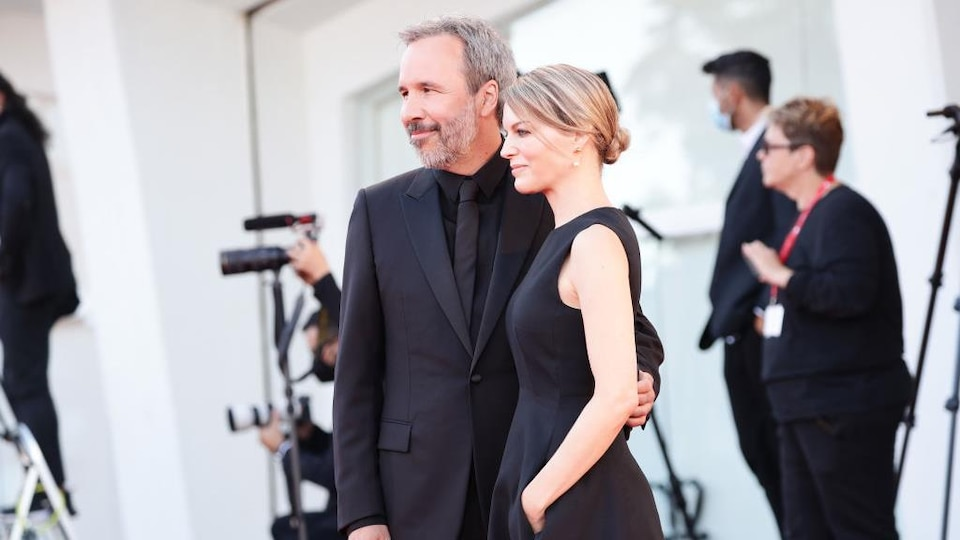 A woman and a man wearing black clothes.