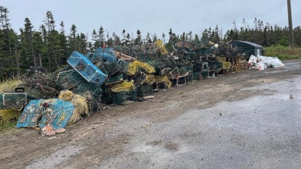 There are many lobster traps on the roadside.