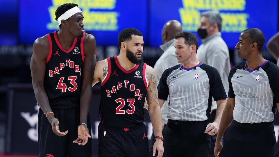 Pascal Siakam and Fred Vanfleet of the Raptors argue with the referees during a match.