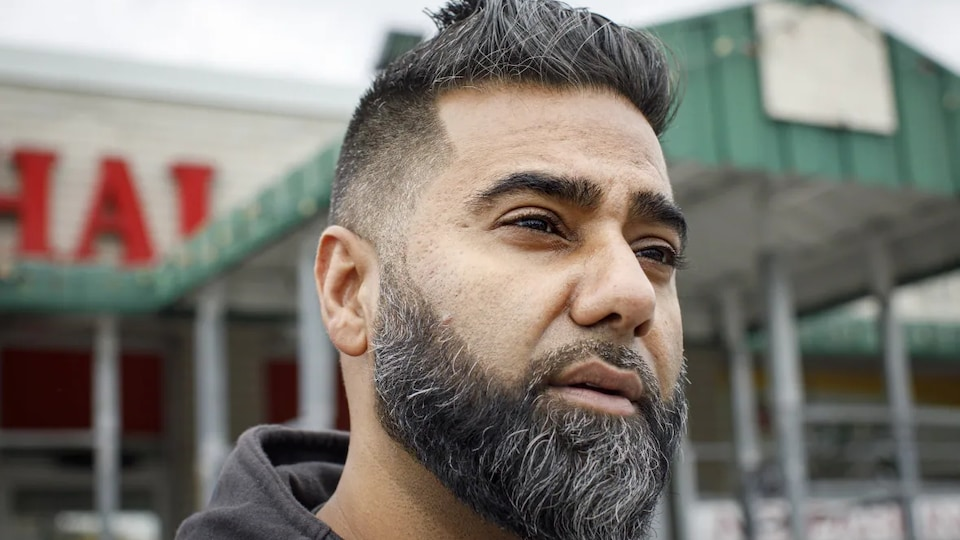 Close-up of the face of a man with a beard and short hair.