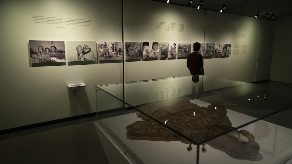 A man looks at the exhibit.