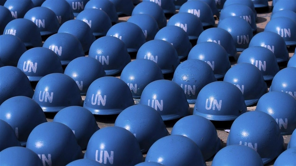 Blue helmets on the ground.